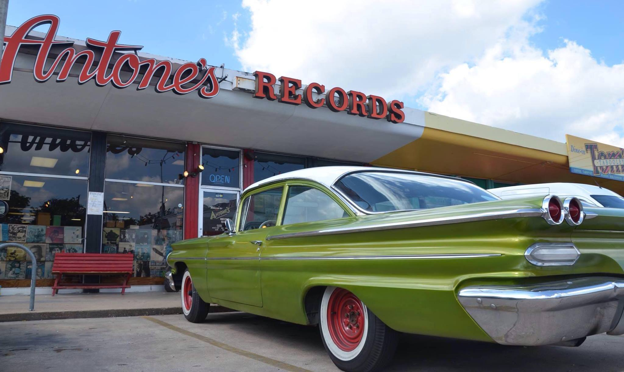 Image of a classic car in front of Antone's Record Shop. Check out our list of places to visit along miles 13-18 of the Austin Marathon course the next time you explore Austin.