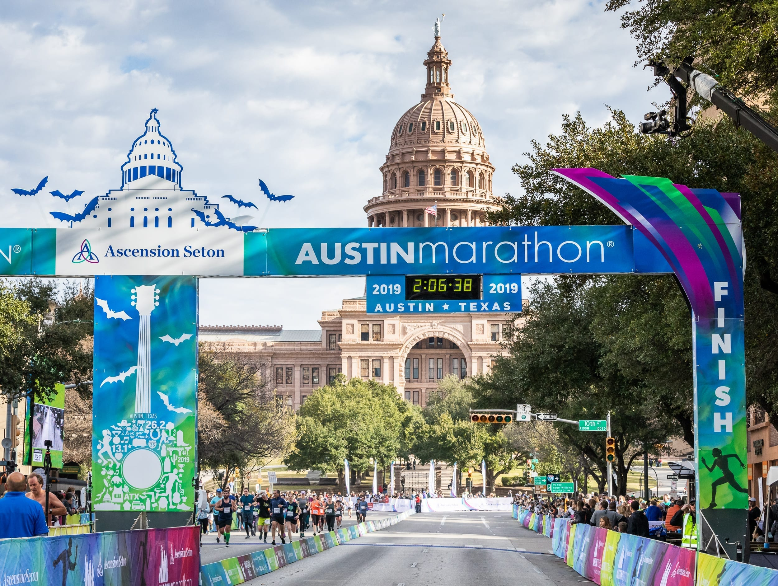Image of the 2019 Ascension Seton Austin Marathon finish line with the Texas State Capitol in the background. Follow the GU Energy Labs advice in this blog about proper nutrition to help you get to the 2020 Ascension Seton Austin Marathon finish line.