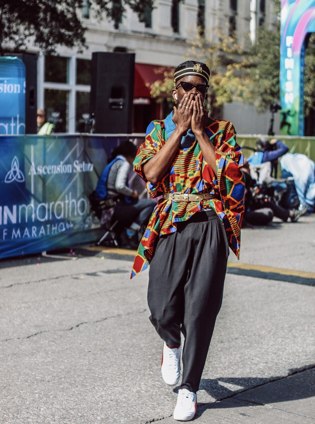 Drake Muyinza crosses the finish line in his final outfit during the Austin Marathon. He turned the 26.2-mile course into the World's Longest Fashion Runway!