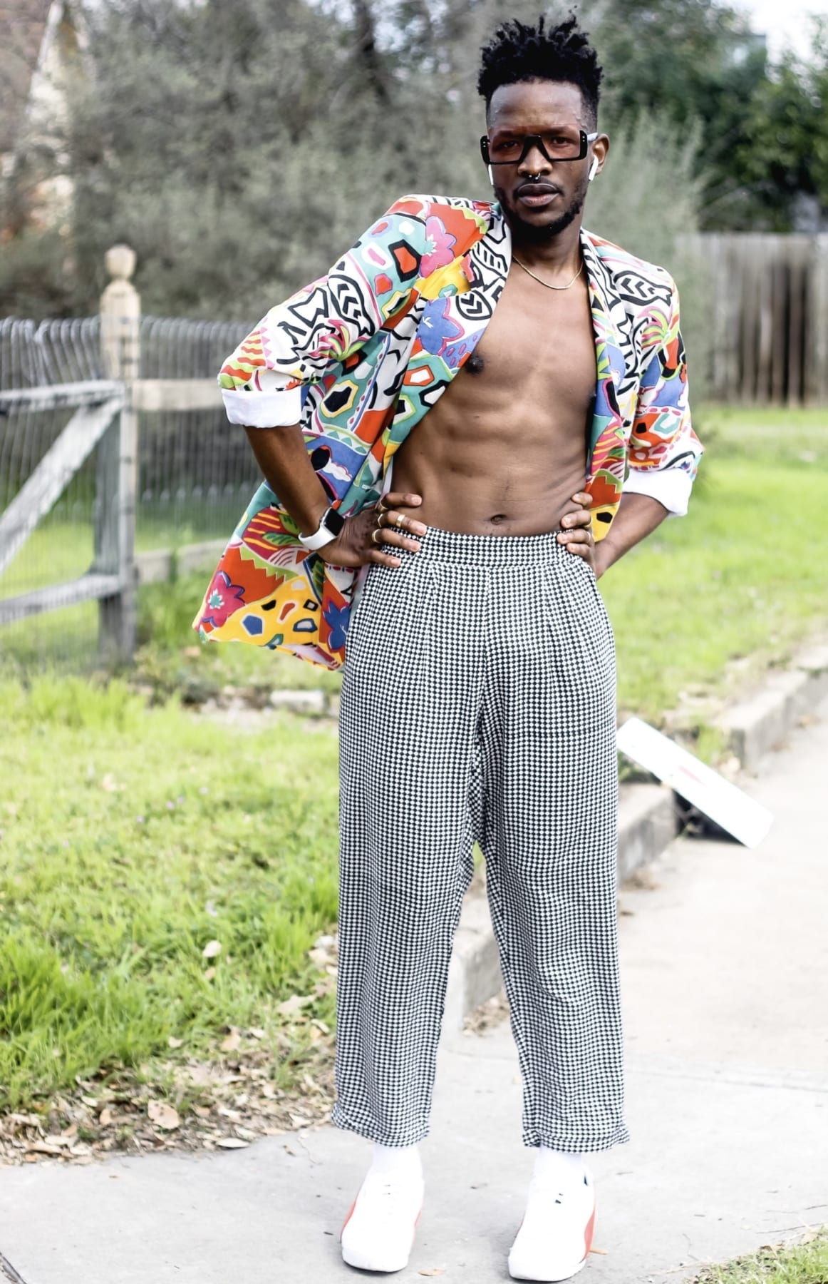Drake Muyinza poses in his fifth outfit during the Austin Marathon. He turned the 26.2-mile course into the World's Longest Fashion Runway!