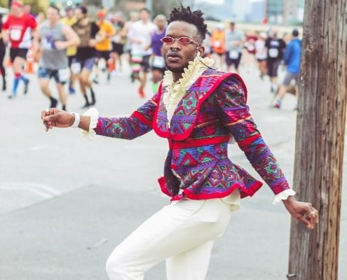 Drake Muyinza poses in his second outfit during the Austin Marathon. He turned the 26.2-mile course into the World's Longest Fashion Runway!