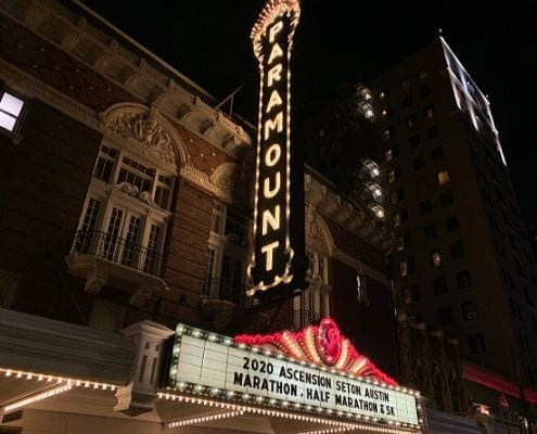 Image of the Paramount Theatre marquee displaying the 2020 Ascension Seton Austin Marathon name. The Austin Marathon donates nearly $23,000 to Paramount Theatre. Paramount is the beneficiary of the KXAN SimpleHealth 5K.
