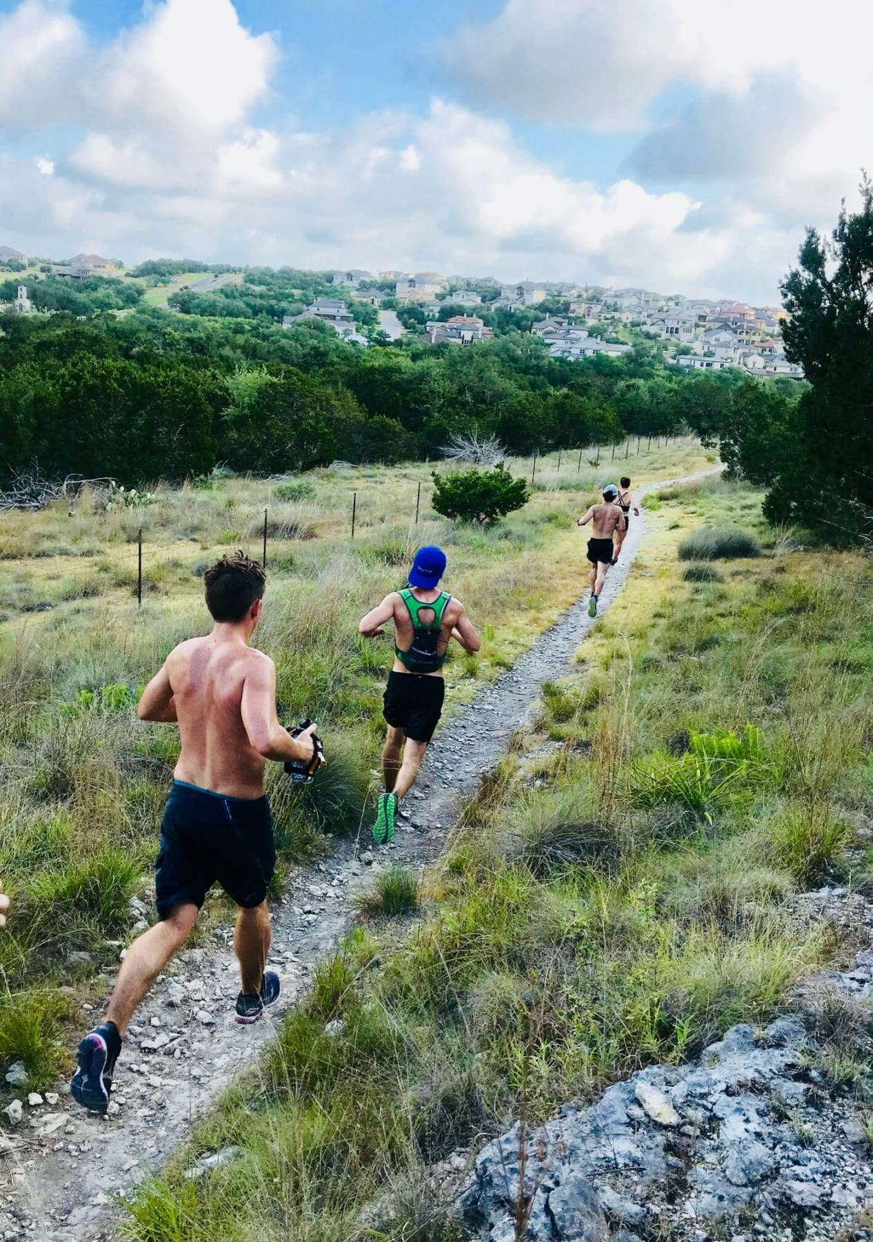 Image of runners running one of Austin's top running trails. Credit to Trail Roots.