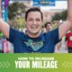 Image of male runner with his hands raised in the air in celebration after crossing the 2019 Ascension Seton Austin Marathon. Design on the image contains text that reads How to Increase Your Mileage.