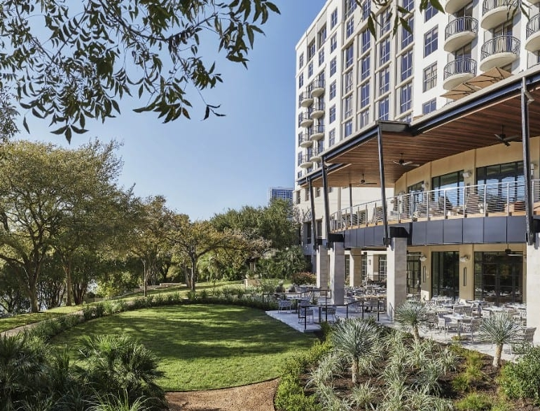 Image of Four Seasons Hotel Austin overlooking Lady Bird Lake. Book a luxury hotel and make your Austin Marathon weekend that much more memorable. More information at https://youraustinmarathon.com/austin-luxury-hotels/