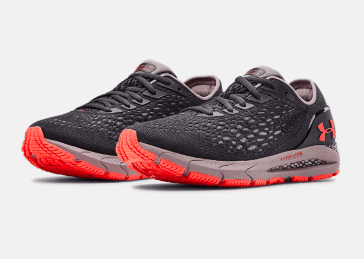 Pair of grey and orange women's Under Armour HOVR Sonic 3s. It's crucial to have the perfect pair of shoes when you start marathon training. Read about more items you need at https://youraustinmarathon.com/items-to-start-marathon-training/