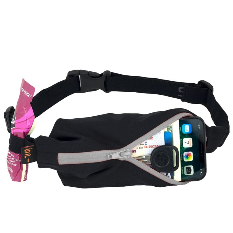 Image of a SPIbelt holding a phone in its pocket and a gel in the clip. A good running belt is nice to have when you start marathon training. Read about more items you need at https://youraustinmarathon.com/items-to-start-marathon-training/
