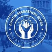 Runners cross the 2020 Austin Marathon finish line with the Texas State Capitol in the background. Overlaying the image is the new logo of Austin Marathon Gives, the Austin Marathon's philanthropic program. Learn more at https://youraustinmarathon.com/austin-marathon-gives/