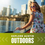 Female smiles while kayaking on Town Lake, one of the many amazing outdoor spaces in Austin. Read more at https://youraustinmarathon.com/outdoor-spaces-in-austin/