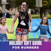 Image of a mom running towards the Austin Marathon finish line with her two children. Text on design reads 2020 Holiday Gift Guide. Learn more at https://youraustinmarathon.com/2020-holiday-gift-guide/