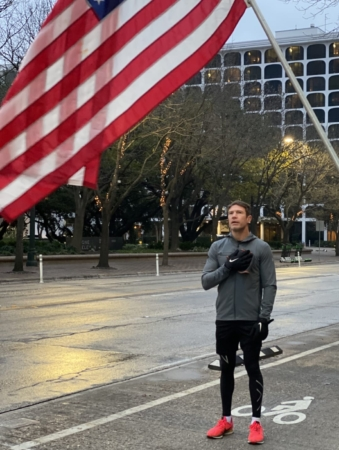 Nate Boyer covers his heart with his right hand as the National Anthem played before he ran 26.2 miles on Austin's streets. Boyer helped fundraise more than $21,000 for Dell Children's Heart Program.