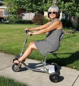Gail on HandyScoot in neighborhood