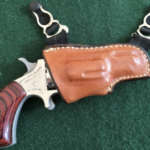 gun in a holster hanging from a garter