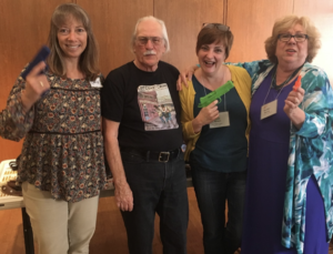 Photo of Jim Guili and three members of Sisters in Crime NorCal Chapter