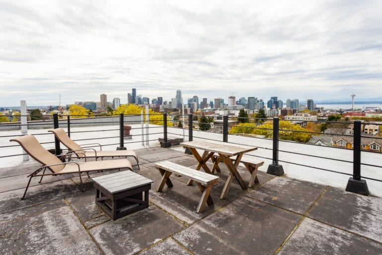 Seattle Pride Parade Rooftop patio with outdoor seating and city views