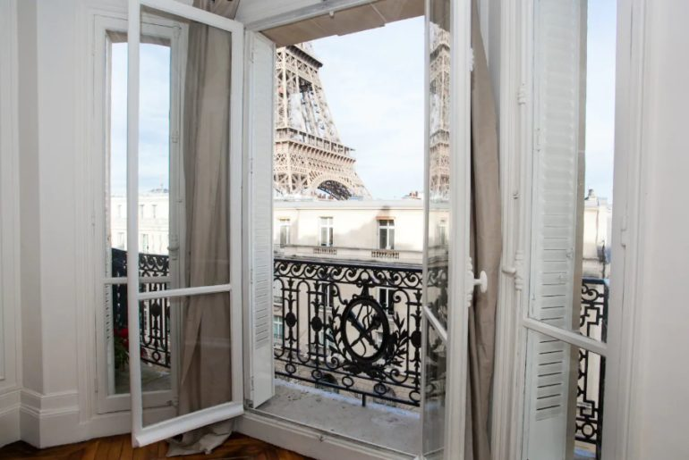 Giant picture windows with views of the Eiffel Tower