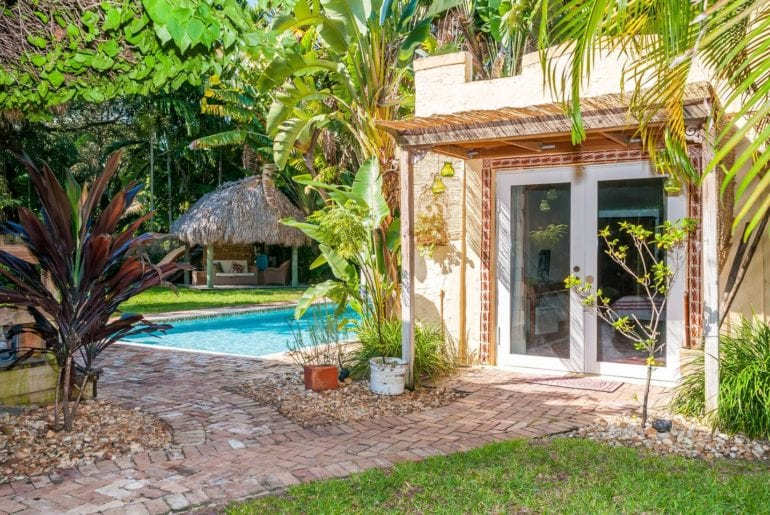 Charming poolside cottage surrounded by palm trees. Miami on the cheap.
