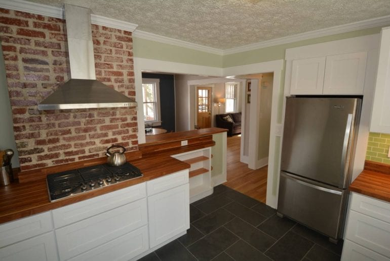 Exposed brick in the spacious kitchen