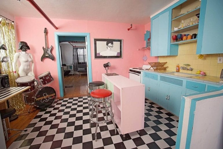 This retro kitchen is a set for a cooking series, complete with drums and Darth Vader helmet. Miami on the cheap.