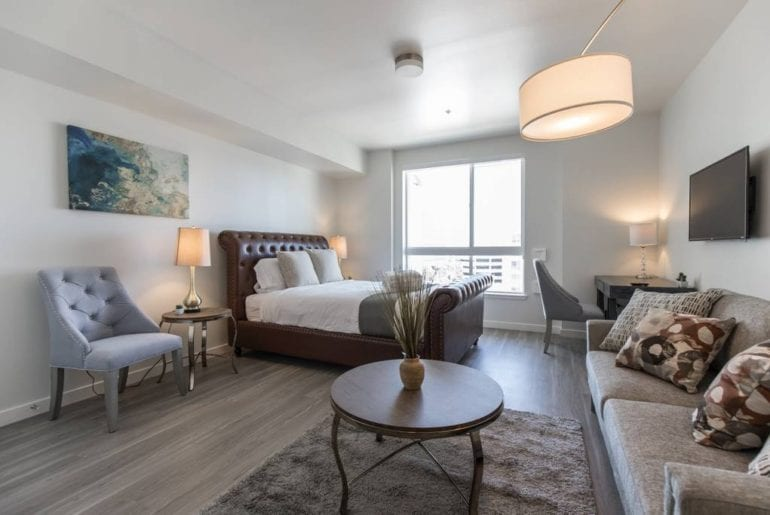 This studio apartment has amazing views of Downtown LA and features a lot of stylish decor