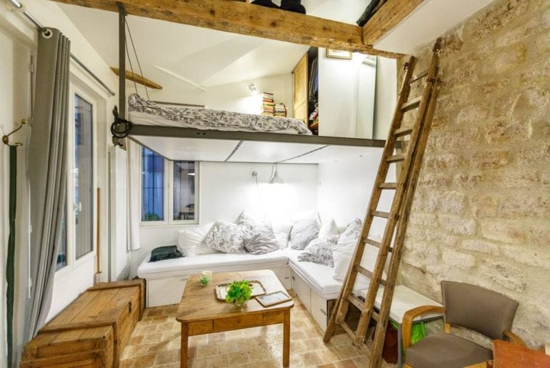 Loft style bedroom with rustic features