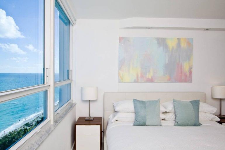 This modern style condo has 180 degree views of Miami Beach. Miami on the cheap.