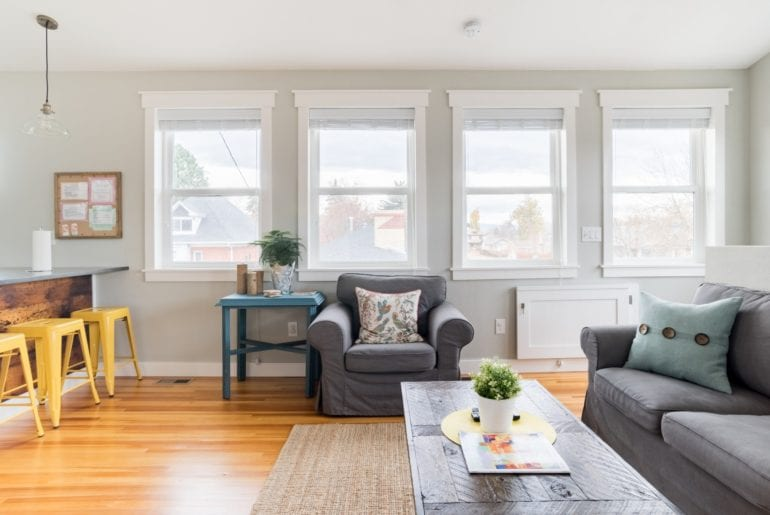 This living room has giant windows - giving the space a bright and energizing vibe