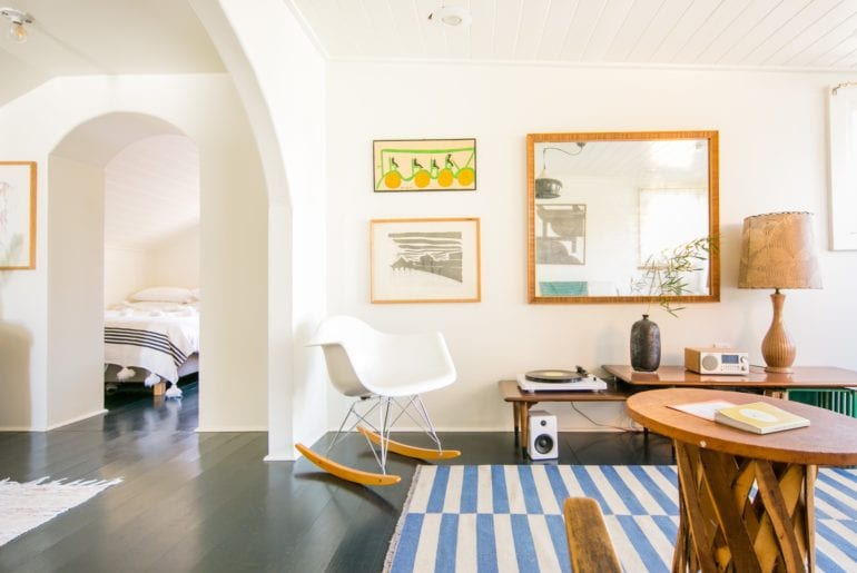 This apartment is bright with a simple design and mid-century flair