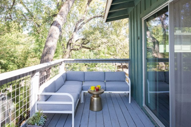 Austin Hilton The outdoor deck has wonderful seating including a sofa and sun loungers