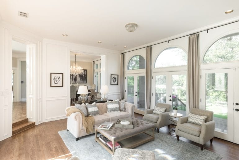 This house has neutral tones and a bright, spacious feel with enormous glass doors.