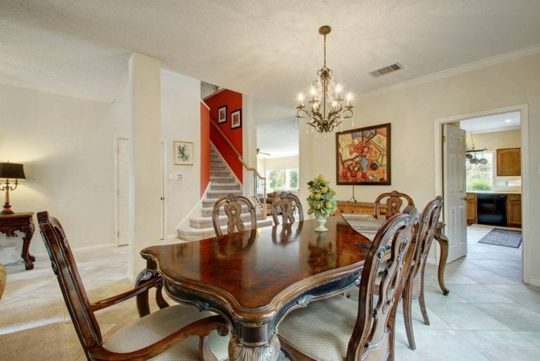 This is one of the three dining areas in this large home, with a full dining room set and chandelier