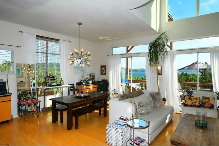 The second level of this home has breathtaking views of Lake Travis and is uniquely decorated with a bright feel