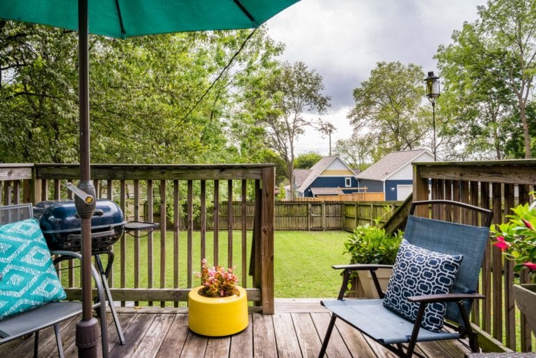The outdoor space is perfectly groomed and is complete with a BBQ grill and outdoor seating