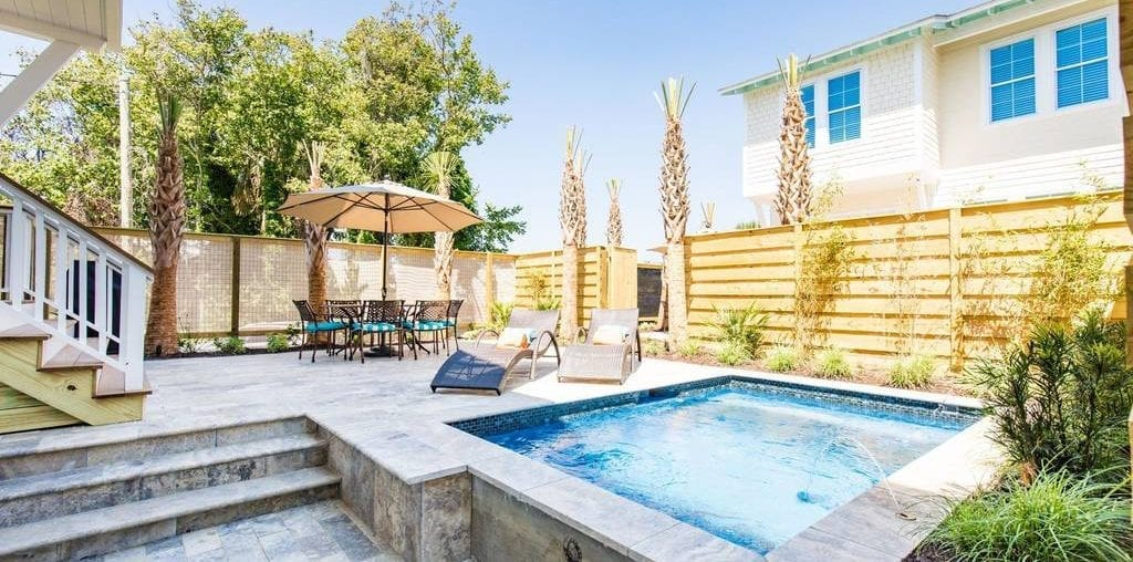 Beautiful patio with an in-ground pool at one of the Folly Beach vacation rentals