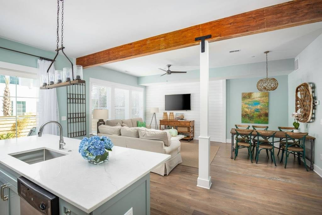 Exposed beams and bright colors elevate the shack vibes at one of the best Folly Beach vacation rentals