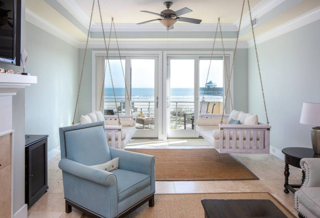 Folly Beach hotels have nothing on this chic condo living room with swinging  couches and panoramic ocean views