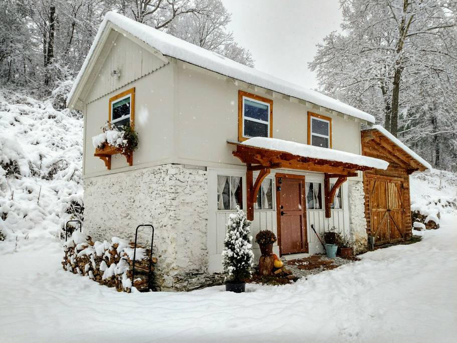 Snow falls outside of this idyllic coach house