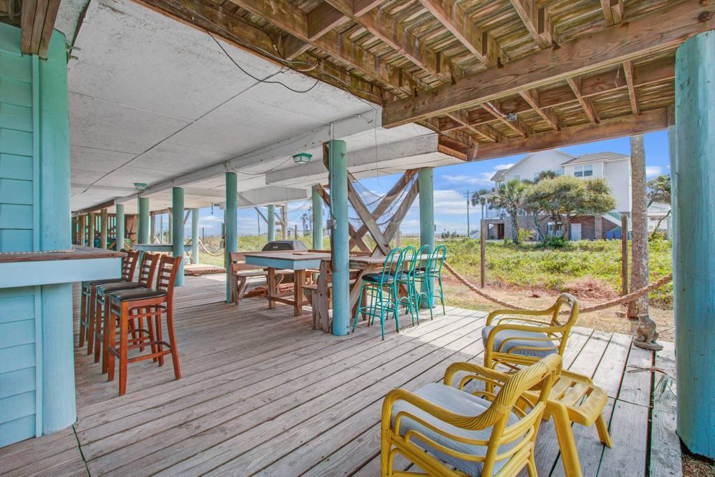 Hang out at the personal lounge of this rental featuring a private bar, picnic table, lounge chairs, and a great view of the beach