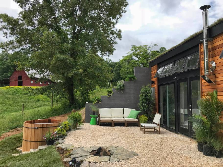 Gravel patio of this underground home is one of the best airbnbs in Asheville