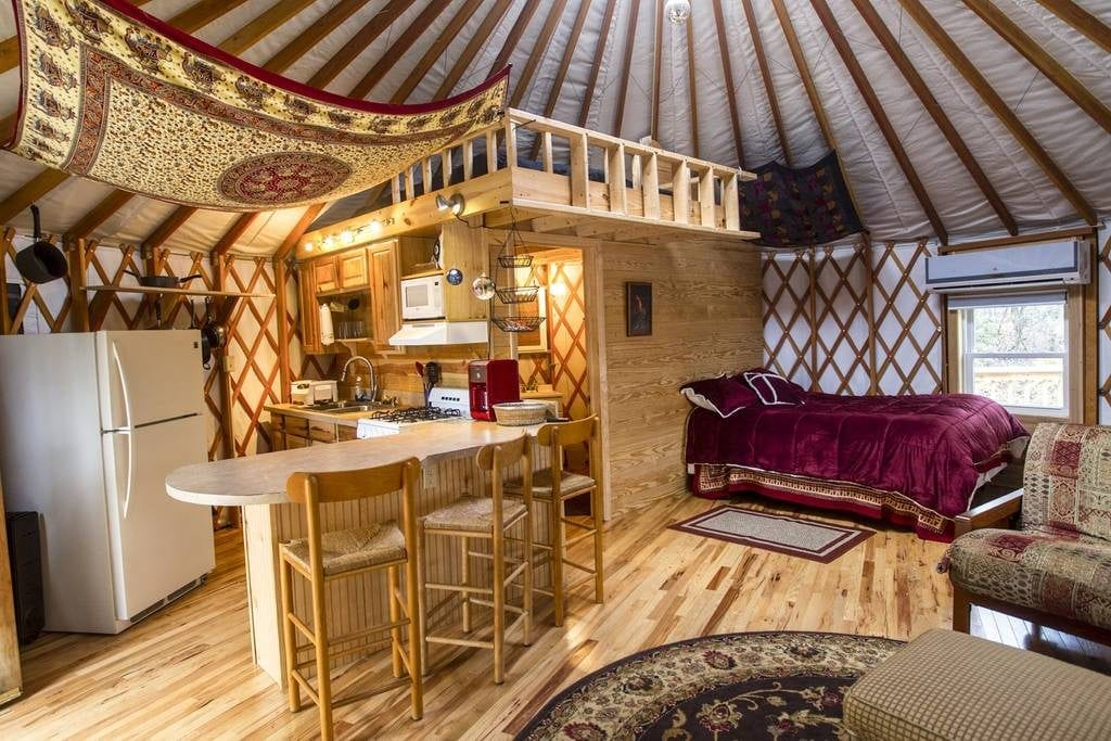 Invitingly warm inside of this yurt in the woods