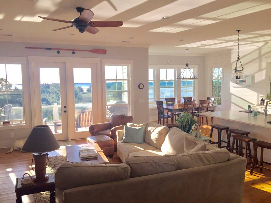 Living and dining room of this Charleston Airbnb near beaches overlook Mount Pleasant sound