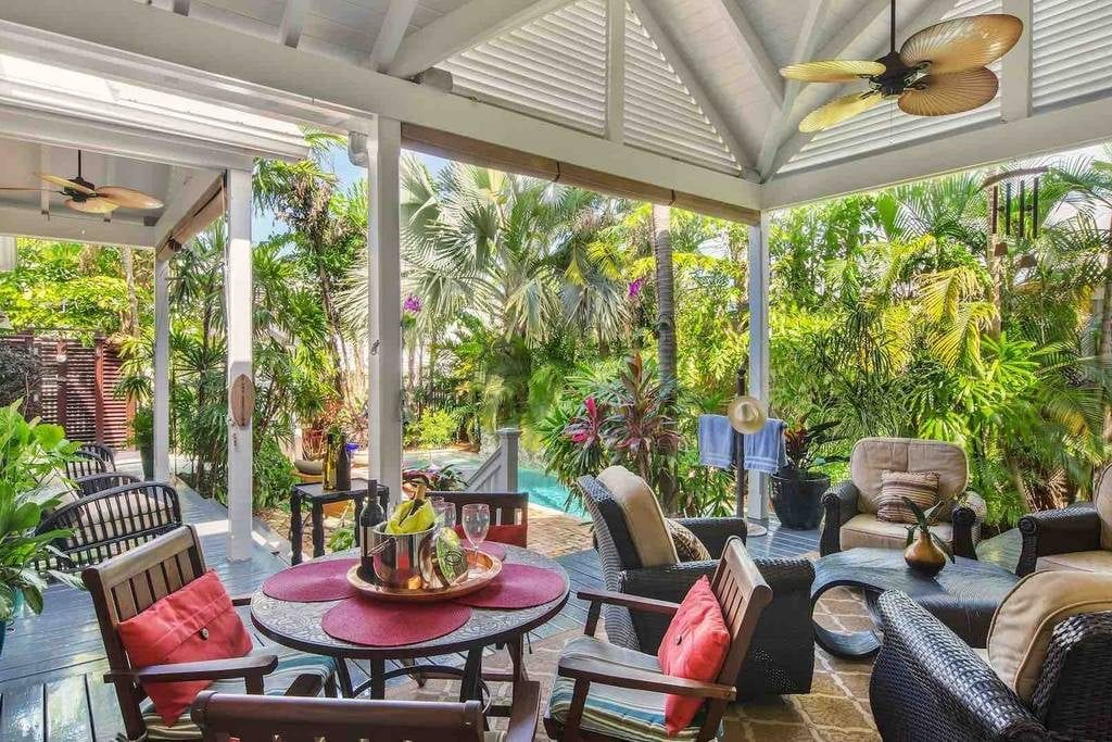 Tropical patio of an Airbnb Key West listing