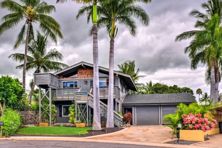 a gorgeous maui vrbo home with palm trees