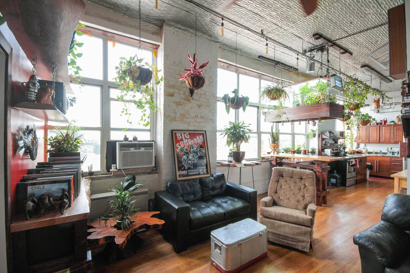 plant filled apartment with views of manhattan