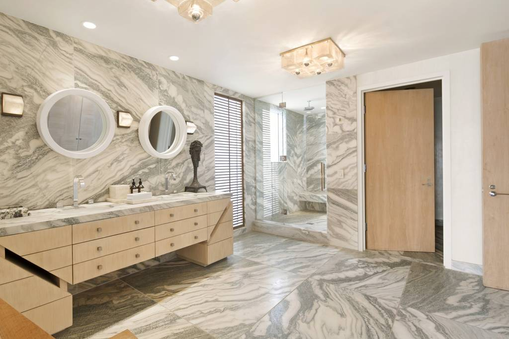 marble bathroom with light wooden paneling in a Los Angeles Airbnb