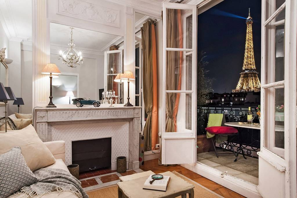 the Eiffel tower at night from a romantic Paris Airbnb