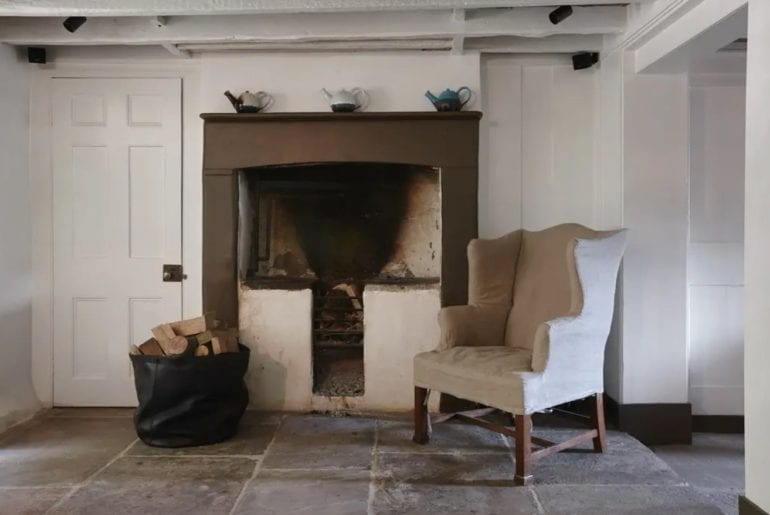 fireplace with stone floors in the foreground