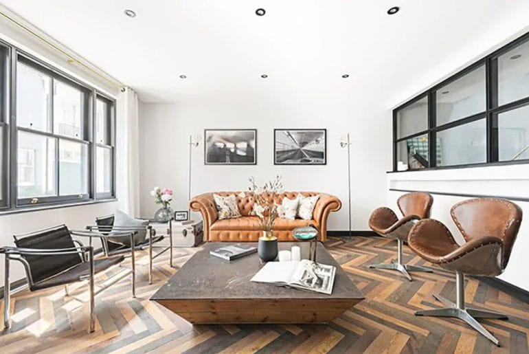 mid century furniture and a couch surrounding a coffee table