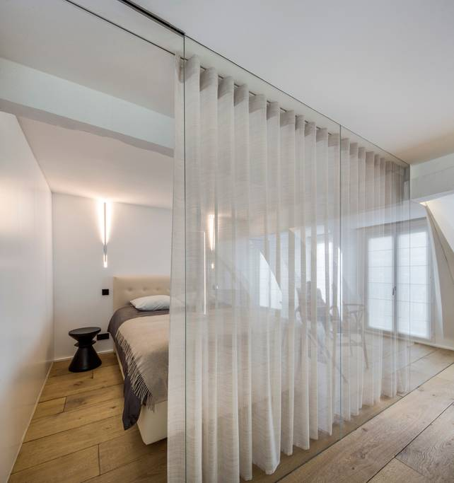 a sheer curtain in the bedroom