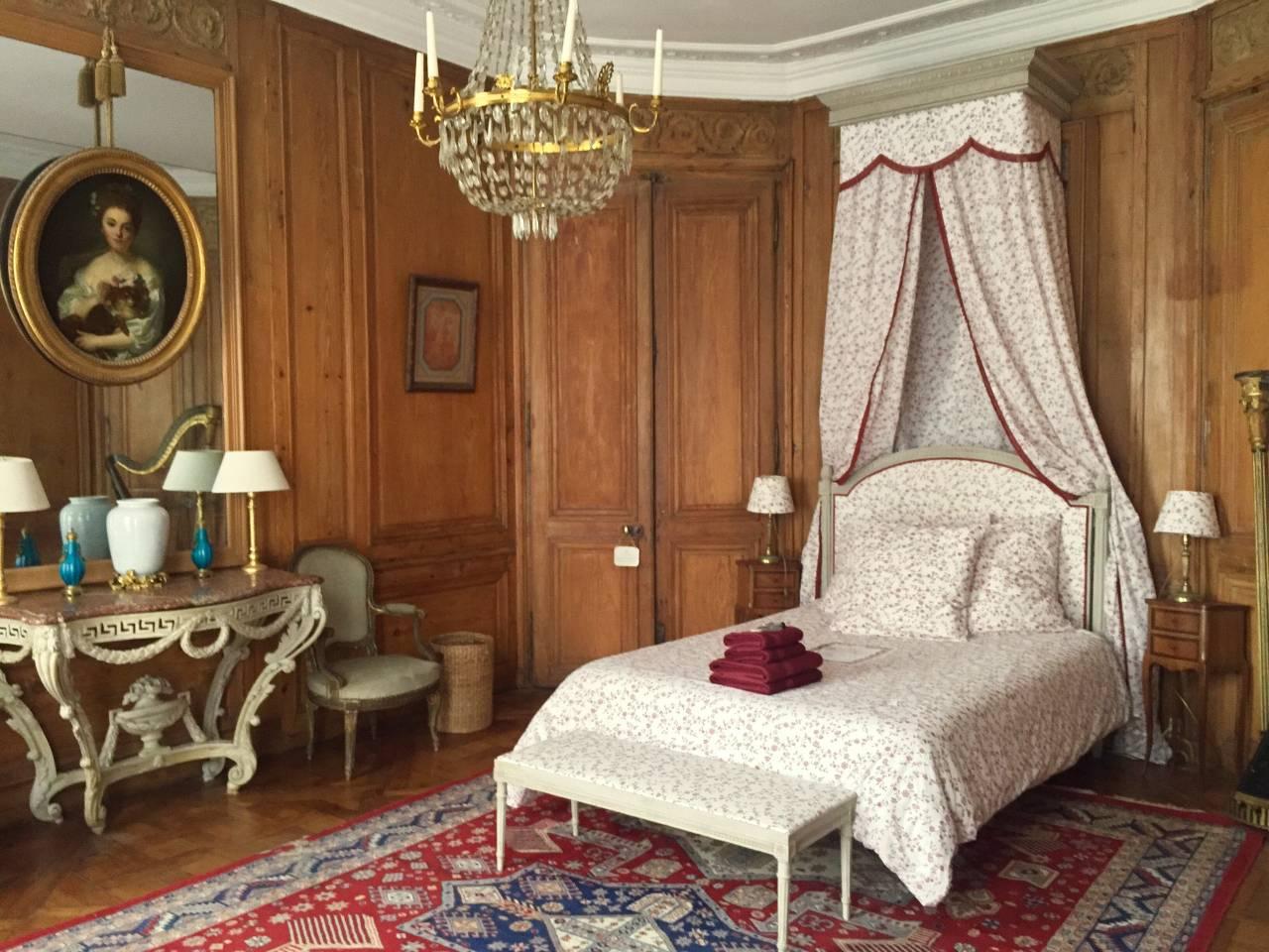 bedroom with chandelier in Paris